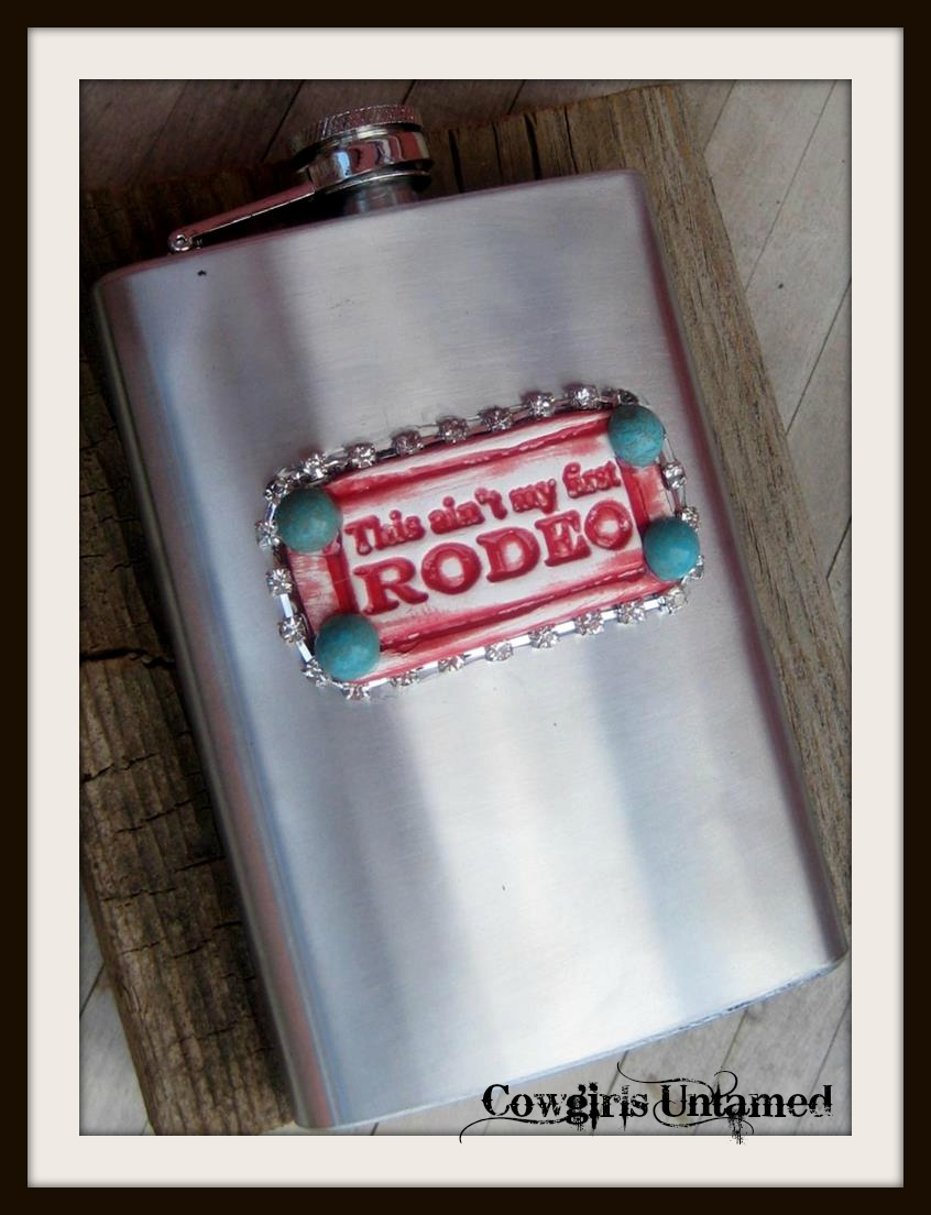 "COWGIRL ATTITUDE DECOR Red ""This Ain't My First Rodeo"" Tag with Turquoise & Rhinestone Trim Stainless Steel 8oz Pocket Hip Western Flask"