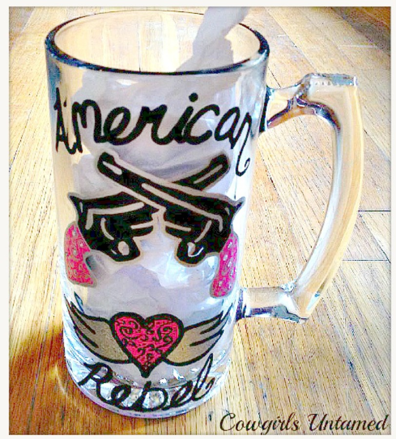 "SASSY COWGIRL DECOR Painted ""American Rebel"" Black and Pink with Double Pistols and Winged Heart Western Glass Mug"