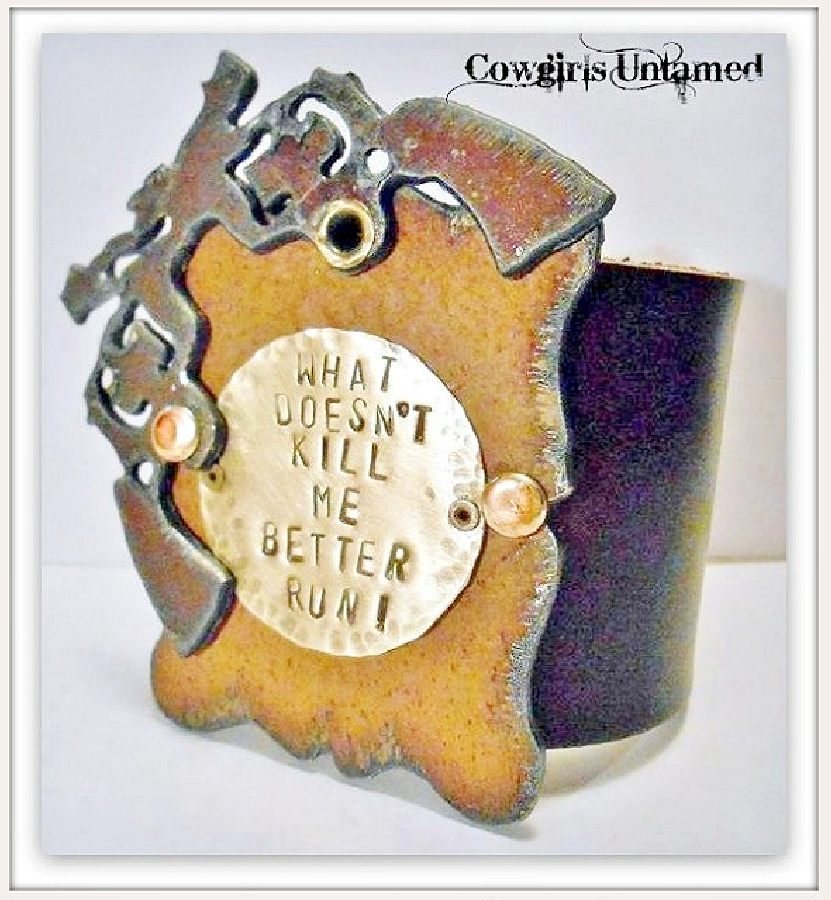 """COWGIRL ATTITUDE CUFF """"What Doesn't Kill Me Better Run"""" Sixshooter Metal Brown Cuff"""